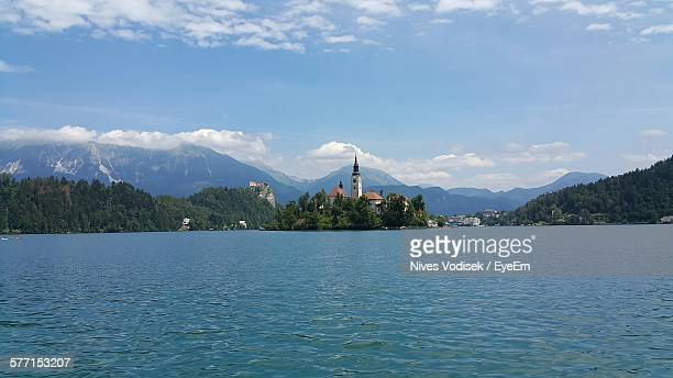 Scenic View Of Lake Bled And Mountains Against Blue Sky