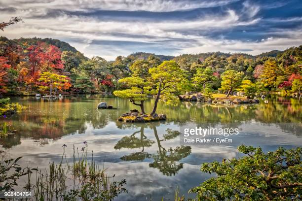 scenic view of lake by autumn trees against sky - kyoto city stock pictures, royalty-free photos & images