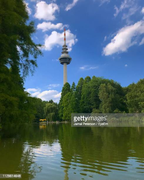 scenic view of lake by building against sky - mannheim stock pictures, royalty-free photos & images