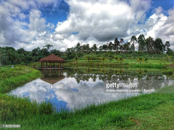scenic view of lake by building against sky - japonês stock pictures, royalty-free photos & images
