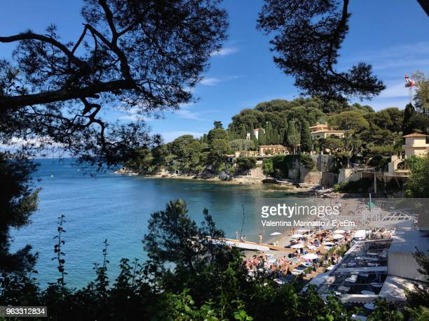 scenic view of lake by buildings against sky - saint jean cap ferrat stock pictures, royalty-free photos & images