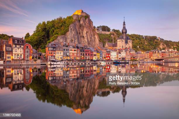scenic view of lake by buildings against sky,dinant,belgium - ナミュール州 ストックフォトと画像