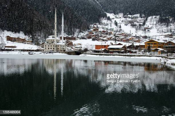 scenic view of lake by buildings during winter - trabzon stock pictures, royalty-free photos & images
