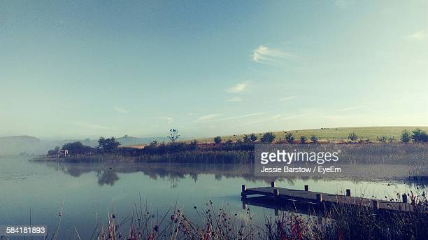 scenic view of lake by field against sky - barstow stock photos and pictures