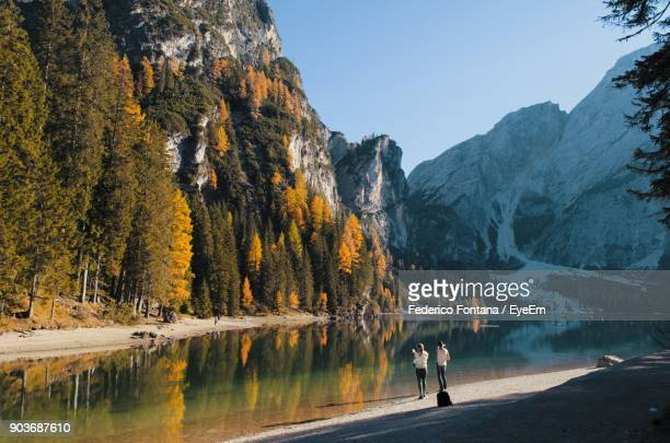 scenic view of lake by mountain against clear sky - pragser wildsee stock pictures, royalty-free photos & images