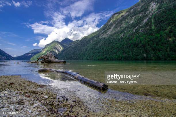 scenic view of lake by mountain against sky - environmental damage stock pictures, royalty-free photos & images