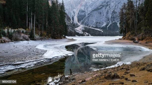 scenic view of lake by mountain against sky - mertens stock pictures, royalty-free photos & images