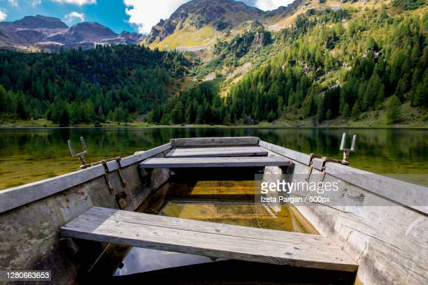 scenic view of lake by mountains against sky,schladming,steiermark,austria - schladming stock pictures, royalty-free photos & images