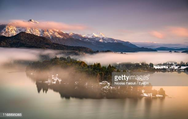 scenic view of lake by mountains against sky during sunset - bariloche stock pictures, royalty-free photos & images
