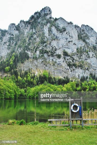 scenic view of lake by mountains against sky - eyeem stock pictures, royalty-free photos & images
