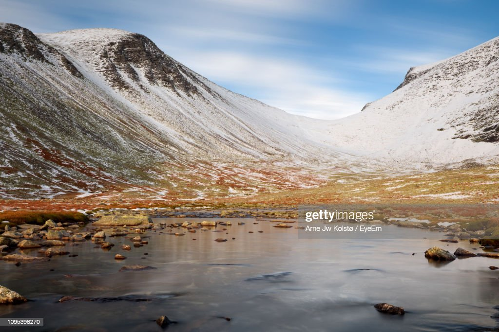 Scenic View Of Lake By Mountains Against Sky : Stock Photo