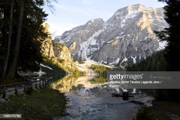 scenic view of lake by mountains against sky - lagarde stock photos and pictures
