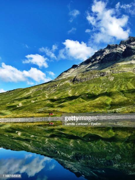 scenic view of lake by mountains against sky - eriksen stock pictures, royalty-free photos & images