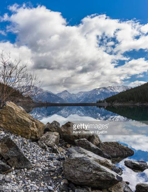 scenic view of lake by mountains against sky - kenin stock pictures, royalty-free photos & images