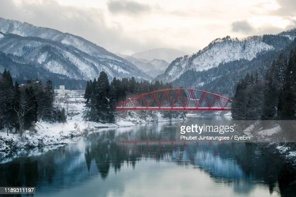 scenic view of lake by mountains against sky - biei town stock pictures, royalty-free photos & images