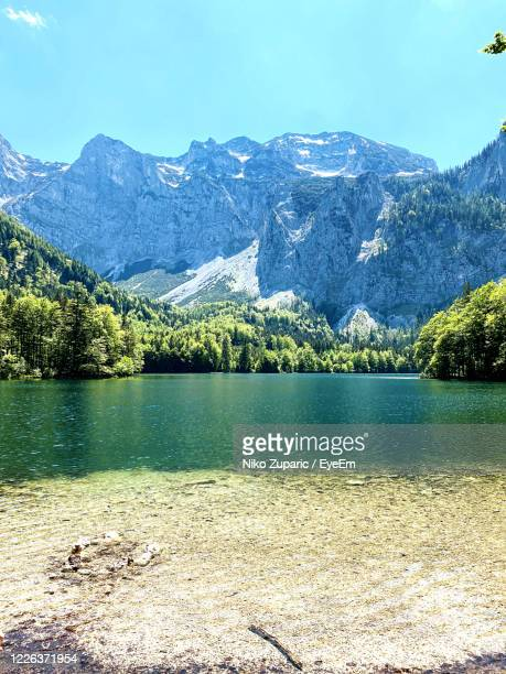scenic view of lake by mountains against sky - upper austria stock pictures, royalty-free photos & images