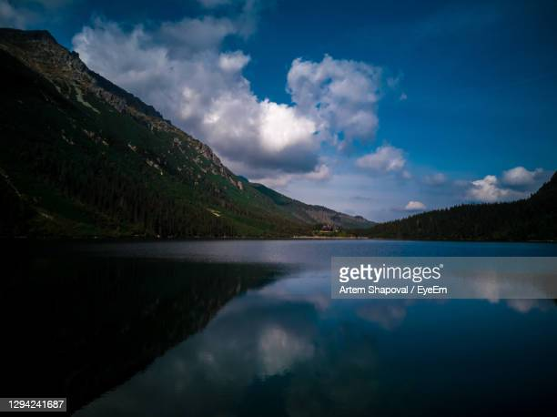 scenic view of lake by mountains against sky - poland stock pictures, royalty-free photos & images