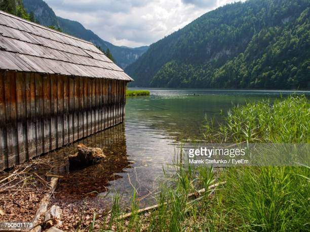 scenic view of lake by mountains against sky - marek stefunko stockfoto's en -beelden