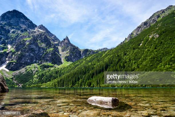 scenic view of lake by mountains against sky, zakopane, poland - poland stock pictures, royalty-free photos & images