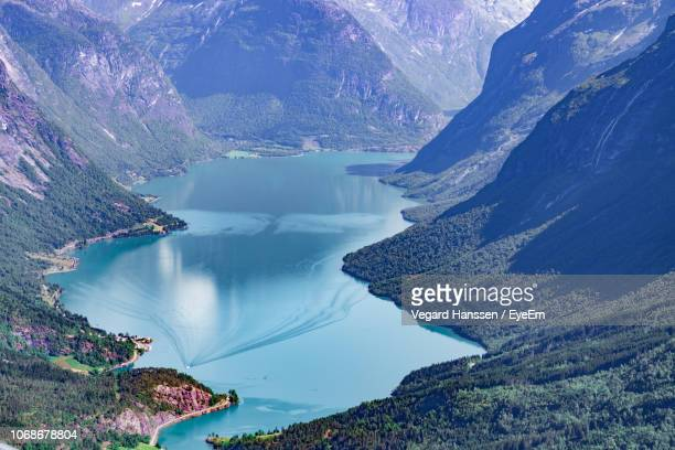 scenic view of lake by mountains - vegard hanssen stock pictures, royalty-free photos & images