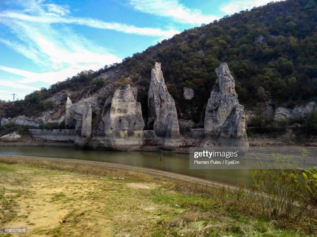 Scenic View Of Lake By Rock Formation Against Sky : Stock Photo