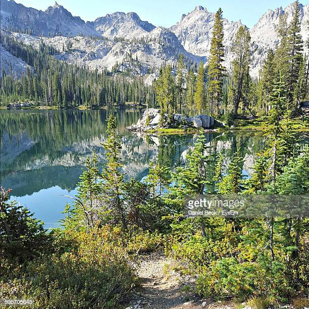 scenic view of lake by sawtooth mountains against sky - sun valley idaho stock photos and pictures