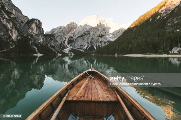 scenic view of lake by snowcapped mountains against sky - pragser wildsee stock pictures, royalty-free photos & images