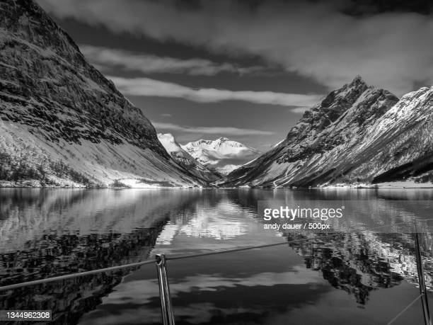 scenic view of lake by snowcapped mountains against sky - andy dauer stock pictures, royalty-free photos & images