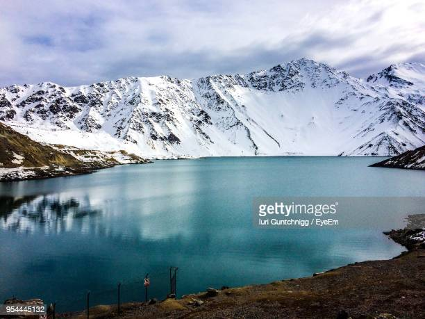 scenic view of lake by snowcapped mountains against sky - santiago chile stock pictures, royalty-free photos & images