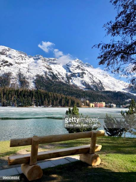scenic view of lake by snowcapped mountains against sky - saint moritz foto e immagini stock