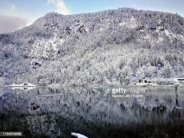 scenic view of lake by snowcapped mountains - thuringia stock pictures, royalty-free photos & images