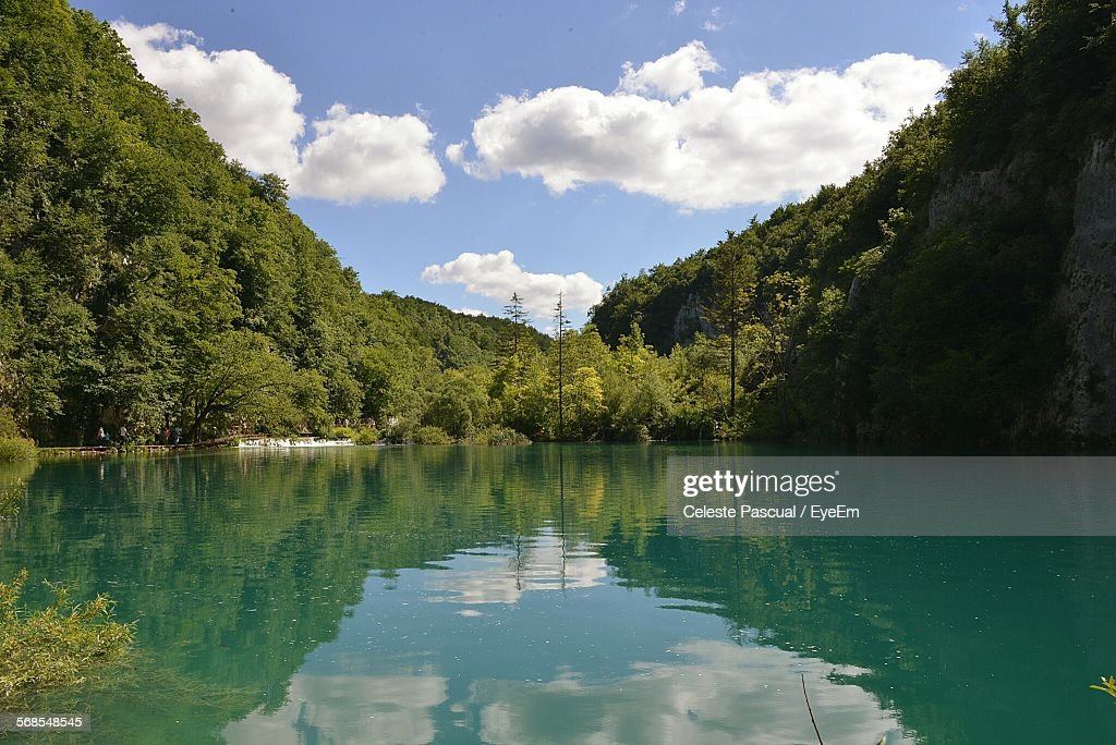 Scenic View Of Lake By Tree Mountains Against Sky : Stock Photo