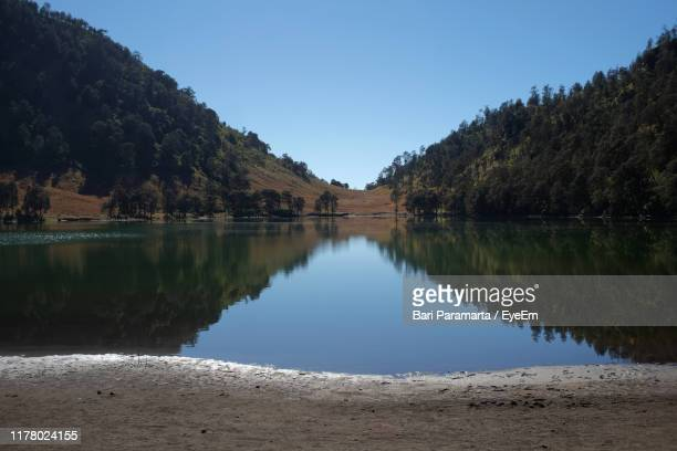 scenic view of lake by trees against clear sky - east java province stock pictures, royalty-free photos & images