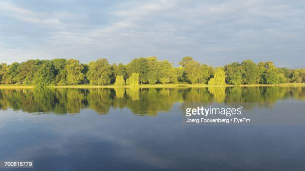 Scenic View Of Lake By Trees Against Sky At Treptower Park