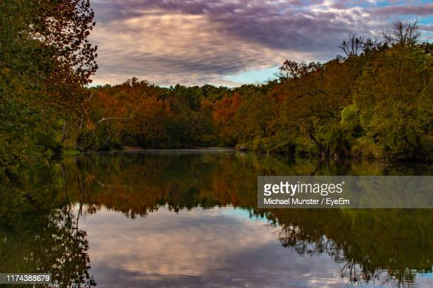 scenic view of lake by trees against sky during autumn - ozark mountains stock pictures, royalty-free photos & images