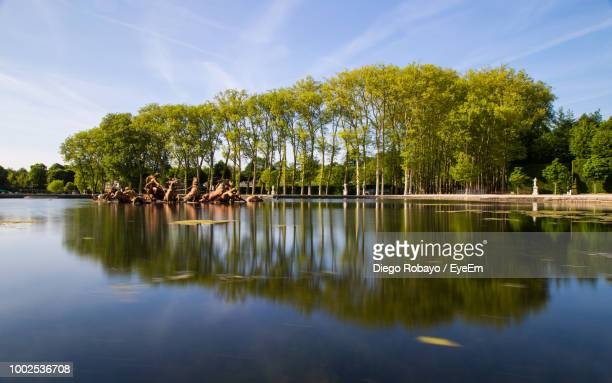 scenic view of lake by trees against sky - yvelines stock pictures, royalty-free photos & images