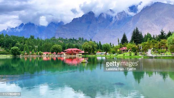 scenic view of lake by trees against sky - pakistan stock-fotos und bilder