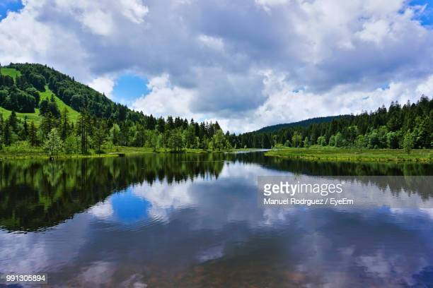 scenic view of lake by trees against sky - lorraine stock pictures, royalty-free photos & images