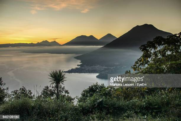 scenic view of lake during sunset - guatemala stock pictures, royalty-free photos & images