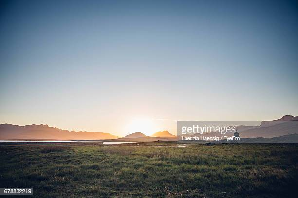 scenic view of lake in front of mountains against clear sky - horizon over land stock photos and pictures