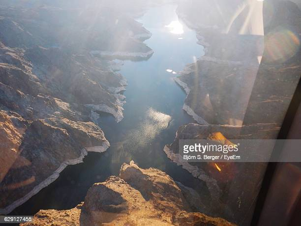 Scenic View Of Lake Mead Amidst Mountains Seen From Airplane Window