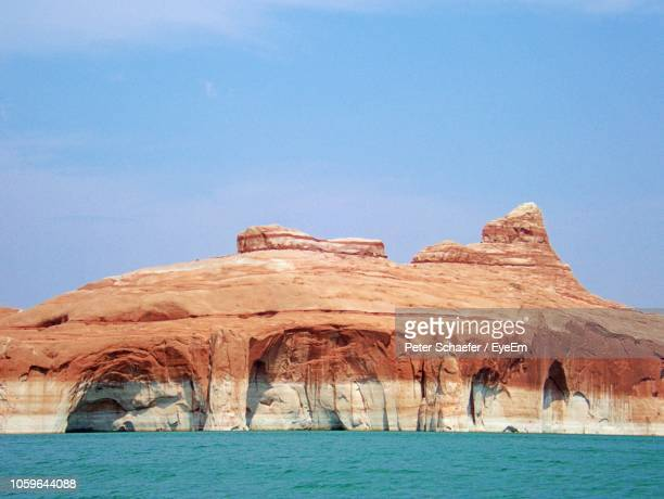 scenic view of lake powell and rock formations against clear blue sky - lake powell stock pictures, royalty-free photos & images