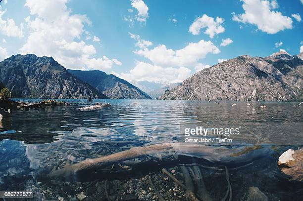 scenic view of lake sary-chelek against cloudy sky - kyrgyzstan stock pictures, royalty-free photos & images