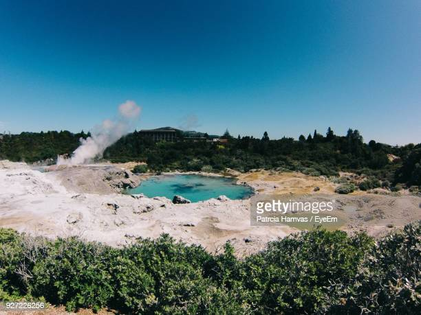 scenic view of lake with hot springs against clear sky - rotorua stock pictures, royalty-free photos & images