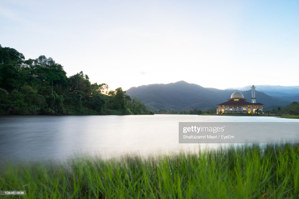 Scenic View Of Lake With Mountains In Background : Stock Photo