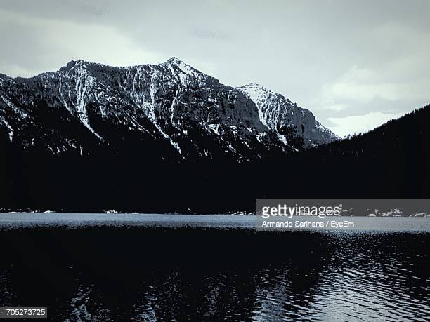 scenic view of lake with mountains in background - bozeman stock pictures, royalty-free photos & images