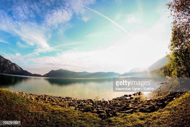 scenic view of lake with mountains in background - coastal feature stock pictures, royalty-free photos & images