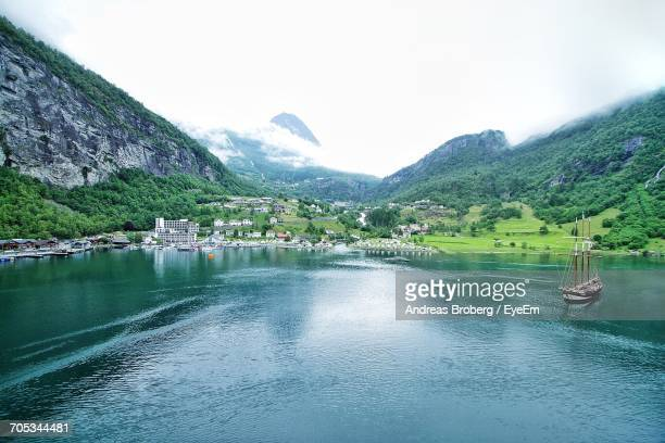 scenic view of lake with mountains in background - roskilde fjord stock pictures, royalty-free photos & images