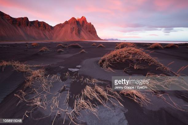 scenic view of land against sky during sunset - black sand stock pictures, royalty-free photos & images