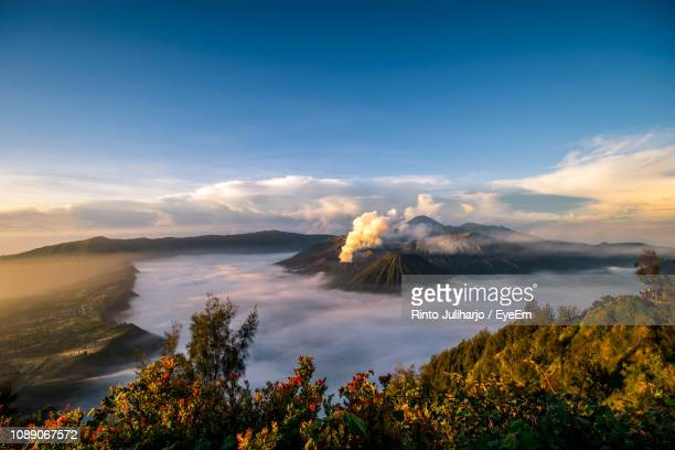 scenic view of land against sky during sunset - bromo tengger semeru national park stock pictures, royalty-free photos & images